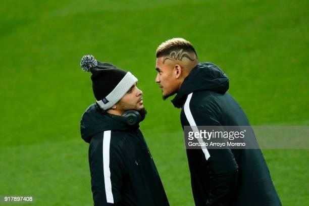 Goalkeeper Alphonse Areola of Paris SaintGermain Football Club and his teammate Adrien Rabiot walk along Estadio Santiago Bernabeu pitch ahead their...