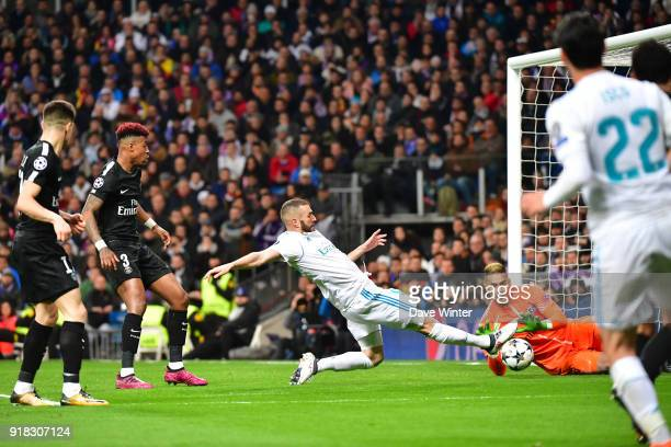 Goalkeeper Alphonse Areola of PSG gathers a cross meant for Karim Benzema of Real Madrid during the Champions League match between Real Madrid and...
