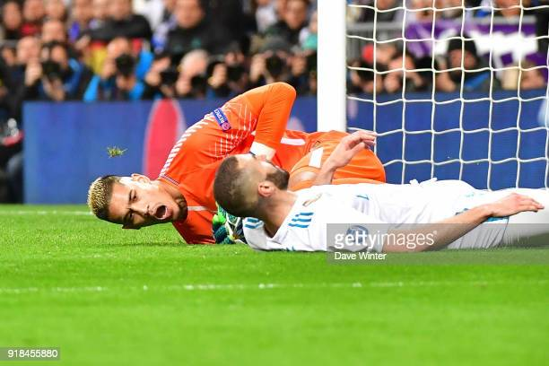 Goalkeeper Alphonse Areola of PSG grabs the ball ahead of Karim Benzema of Real Madrid during the Champions League match between Real Madrid and...