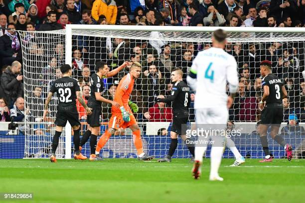 Goalkeeper Alphonse Areola of PSG is congratulated after making a save during the Champions League match between Real Madrid and Paris Saint Germain...
