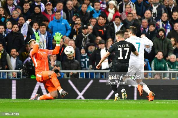 Goalkeeper Alphonse Areola of PSG saves a shot from Cristiano Ronaldo of Real Madrid with his face during the Champions League match between Real...