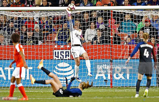 Goalkeeper Alyssa Naeher of the United States saves a goal against Switzerland during an international friendly match at Rio Tinto Stadium on October...