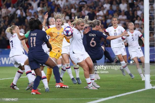 Goalkeeper Alyssa Naeher of the USA looks on after failing to clear a cross during the 2019 FIFA Women's World Cup France Quarter Final match between...