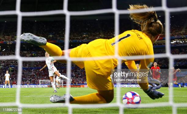 Goalkeeper Alyssa Naeher of the USA saves a penalty from Steph Houghton of England during the 2019 FIFA Women's World Cup France Semi Final match...