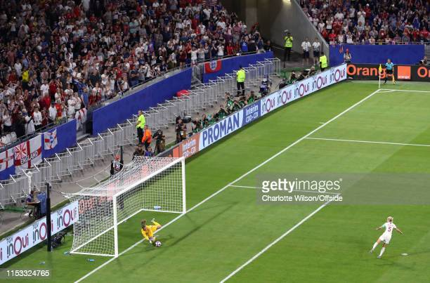 USA goalkeeper Alyssa Naeher saves the penalty of Steph Houghton of England during the 2019 FIFA Women's World Cup France Semi Final match between...