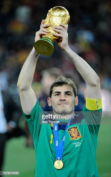 Goalkeeper and captain Iker Casillas of Spain holds aloft the trophy after the 2010 FIFA World Cup Final between the Netherlands and Spain on July 11...