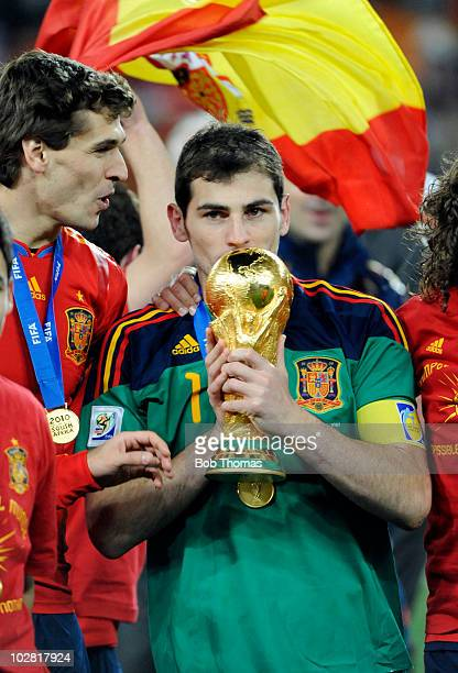 Goalkeeper and captain Iker Casillas of Spain kisses the World Cup after the 2010 FIFA World Cup Final between the Netherlands and Spain on July 11...