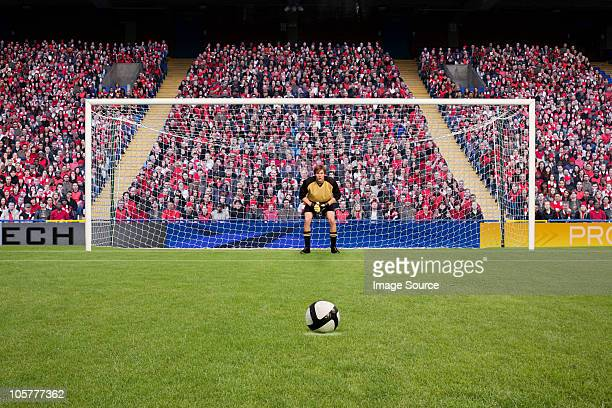 goalkeeper and football - goalie goalkeeper football soccer keeper stock pictures, royalty-free photos & images