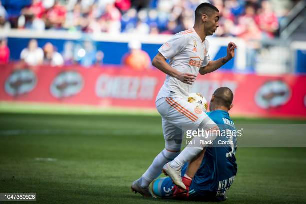 Goalkeeper and team captain Luis Robles of New York Red Bulls blocks the advance by Miguel Almiron of Atlanta United drives to the goal during the...