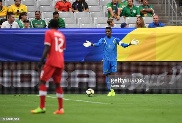 Goalkeeper Andre Blake of Jamaica gestures to Alphonso Davies of Canada prior to kicking the ball down field in a quarterfinal match during the...