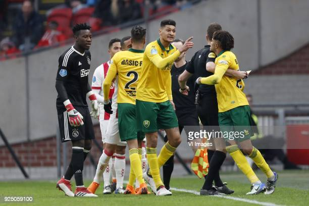 goalkeeper Andre Onana of Ajax Justin Kluivert of Ajax Hakim Ziyech of Ajax Tyronne Ebuehi of ADO Den Haag Bjorn Johnsen of ADO Den Haag referee Pol...