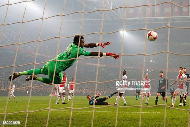 Goalkeeper Andre Onana of Ajax makes the save from a shot from Luuk de Jong of PSV during the Eredivisie match between Ajax Amsterdam and PSV...