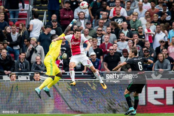 goalkeeper Andre Onana of Ajax Nick Viergever of Ajax Etienne Reijnen of FC Groningen during the Dutch Eredivisie match between Ajax Amsterdam and FC...