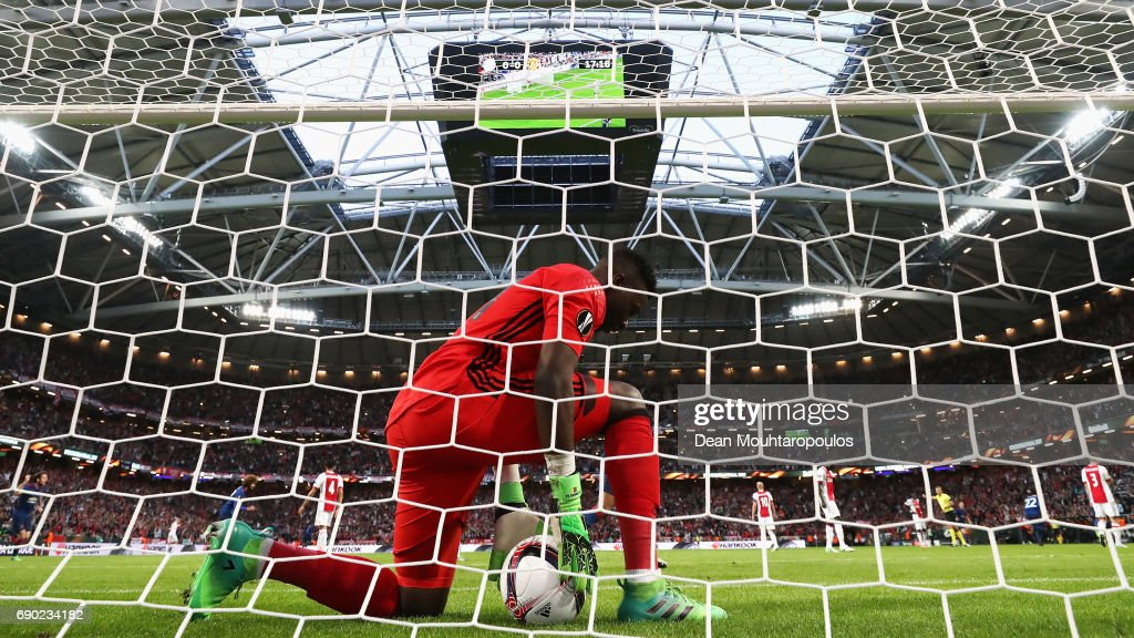 Goalkeeper, Andre Onana of Ajax picks the ball out of the net as Paul Pogba of Manchester United celebrates scoring his sides first goal during the UEFA Europa League Final between Ajax and Manchester United at Friends Arena on May 24, 2017 in Stockholm, Sweden.