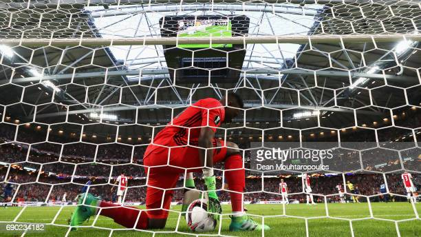 Goalkeeper Andre Onana of Ajax picks the ball out of the net as Paul Pogba of Manchester United celebrates scoring his sides first goal during the...