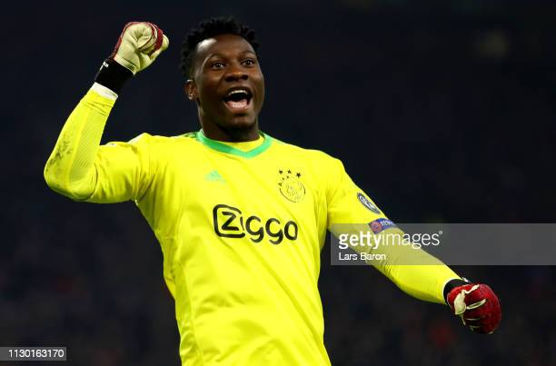 Goalkeeper Andre Onana of Amsterdam celebrates during the UEFA Champions League Round of 16 First Leg match between Ajax and Real Madrid at Johan...