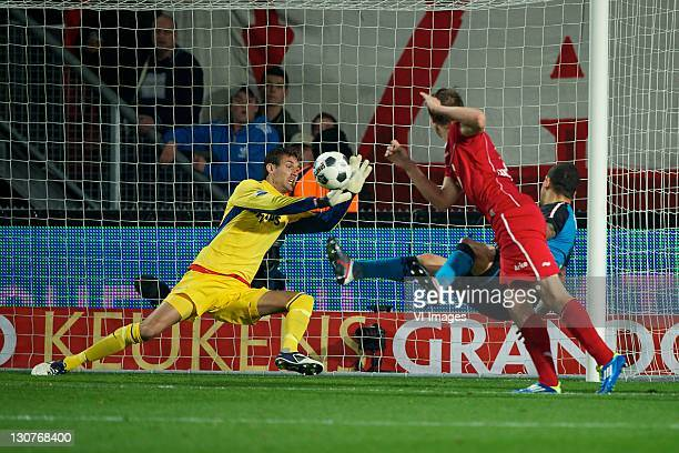 Goalkeeper Andreas Isaksson of PSV reaches for the ball during the Dutch Eredivisie match between Twente Enschede and PSV Eindhoven at the Grolsch...