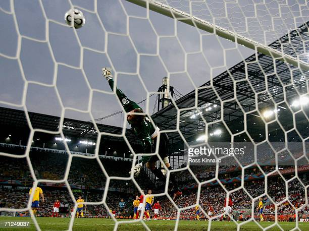 Goalkeeper Andreas Isaksson of Sweden dives but fails to save Joe Cole's shot during the FIFA World Cup Germany 2006 Group B match between Sweden and...