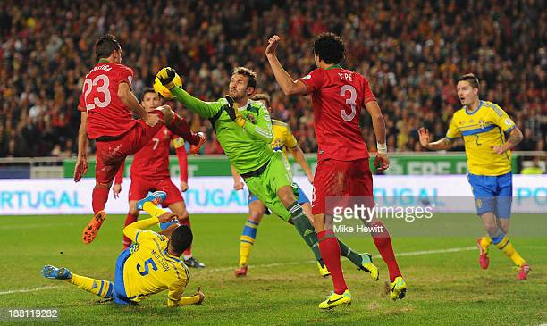Goalkeeper Andreas Isaksson of Sweden is challenged by Helder Postiga of Portugal during the FIFA 2014 World Cup Qualifier Playoff First Leg between...