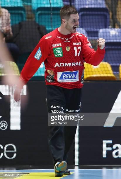 Goalkeeper Andreas Palicka of RheinNeckar Loewen reacts after a save during the EHF Champions League match between Rhein Neckar Loewen and MolPick...