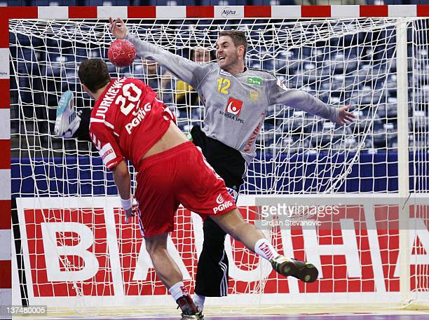 Goalkeeper Andreas Palicka of Sweden stops a shot by Mariusz Jurkiewicz of Poland during the Men's European Handball Championship 2012 main group 1...