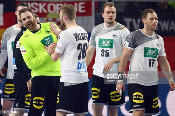 Goalkeeper Andreas Wolff of Germany celebrates with team mate Philipp Weber after winning the Men's Handball European Championship main round group 2...