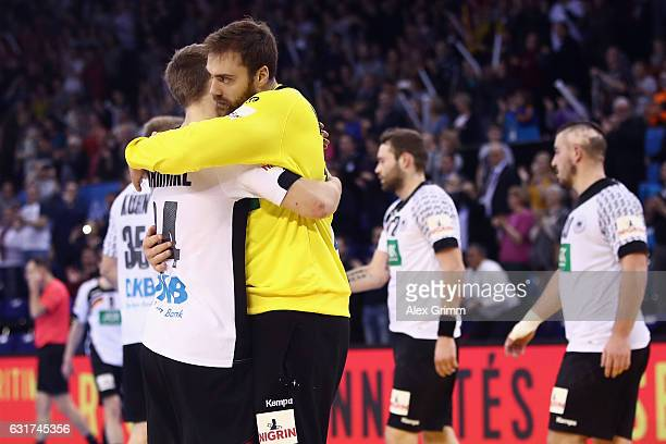 Goalkeeper Andreas Wolff of Germany hugs Rune Dahmke after the 25th IHF Men's World Championship 2017 match between Chile and Germany at Kindarena on...