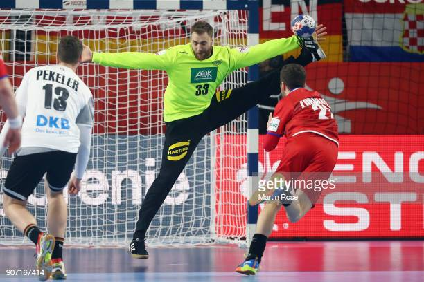 Goalkeeper Andreas Wolff of Germany saves a penalty throw against Ondrej Zdrahala of Czech Republic during the Men's Handball European Championship...
