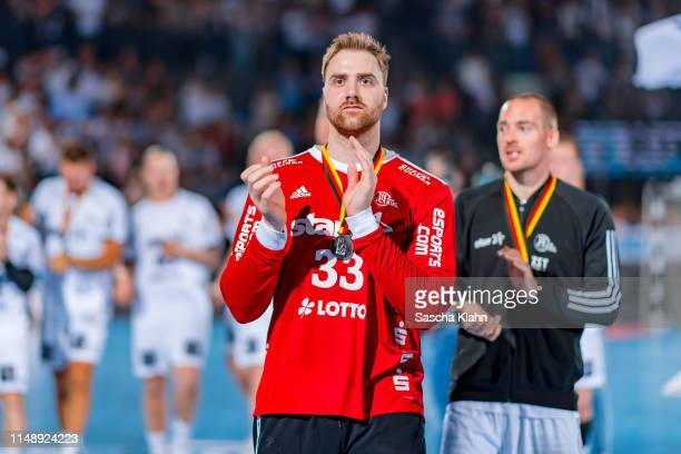 Goalkeeper Andreas Wolff of THW Kiel says farewell to the crowd during the DKB HBL match between THW Kiel and TSV HannoverBurgdorf at Sparkassen...