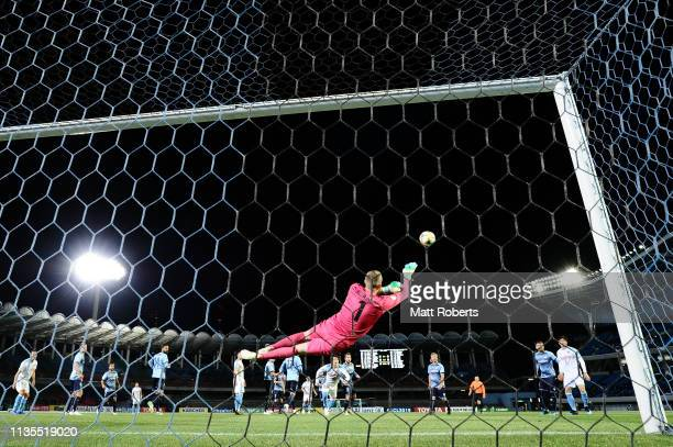 Goalkeeper Andrew Redmayne of Sydney FC dives for the ball during the AFC Champions League Group H match between Kawasaki Frontale and Sydney FC at...