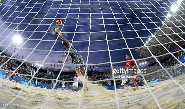 Goalkeeper Andrey Bukhlitskiy of Russia makes a safe during the Men's Beach Soccer semi final match between Portugal and Russia during day fifteen of...