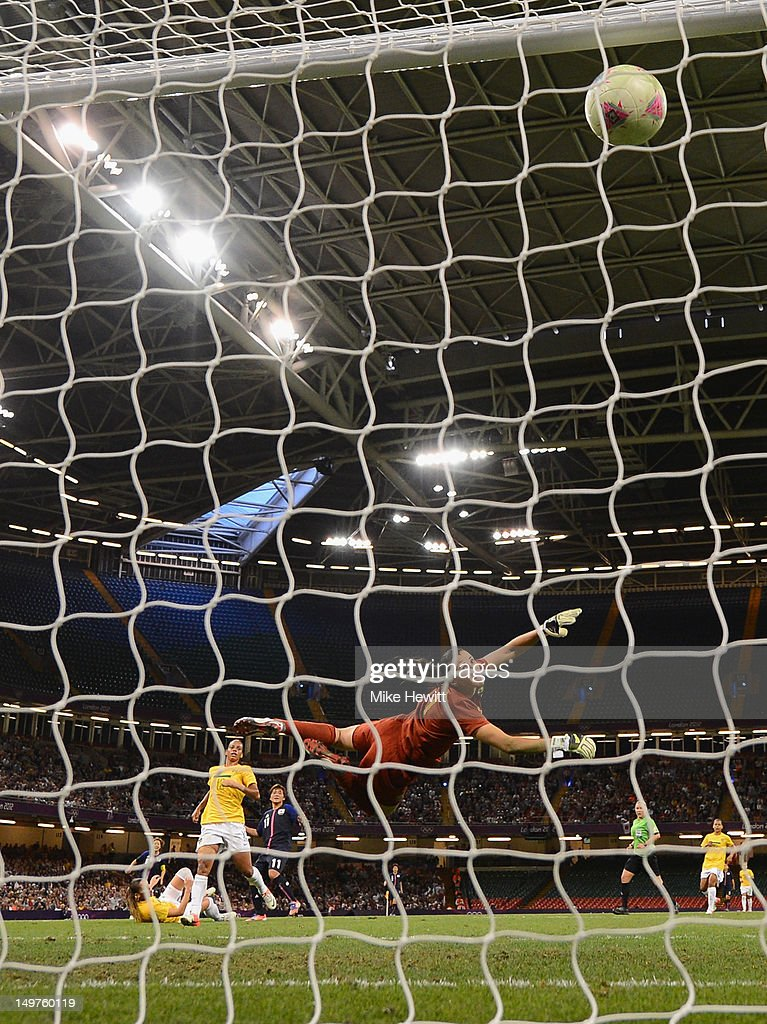 Goalkeeper Andriea of Brazil dives in vein as a shot from Shinobu Ohno of Japan flies into the goal during the Women's Football Quarter Final match between Brazil and Japan, on Day 7 of the London 2012 Olympic Games at Millennium Stadium on August 3, 2012 in Cardiff, Wales.