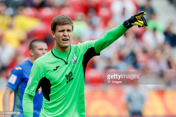Goalkeeper Andriy Lunin of Ukraine gestures during the 2019 FIFA U20 World Cup Quarter Final match between Colombia and Ukraine at Lodz Stadium on...