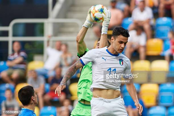 Goalkeeper Andriy Lunin of Ukraine U20 saves the ball next to Gianluca Scamacca of Italy U20 during the 2019 FIFA U20 World Cup Semi Final match...