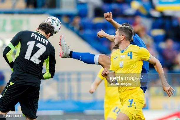 Goalkeeper Andriy Pyatov of Ukraine and Dimitris Christofi of Cyprus battle for the ball during the international friendly match between Ukraine and...