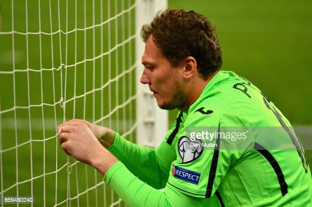 Goalkeeper Andriy Pyatov of Ukraine fixes the goal net during the FIFA 2018 World Cup Group I Qualifier between Ukraine and Croatia at Kiev Olympic...