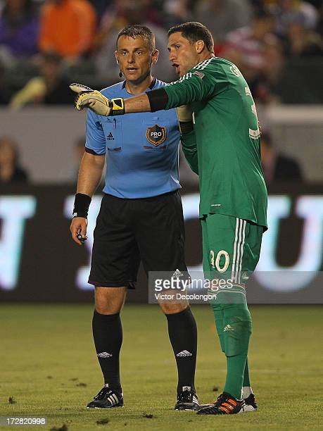 Goalkeeper Andy Gruenebaum of the Columbus Crew argues with referee Sorin Stoica on a foul called in the goal box by Stoica in the second half of the...