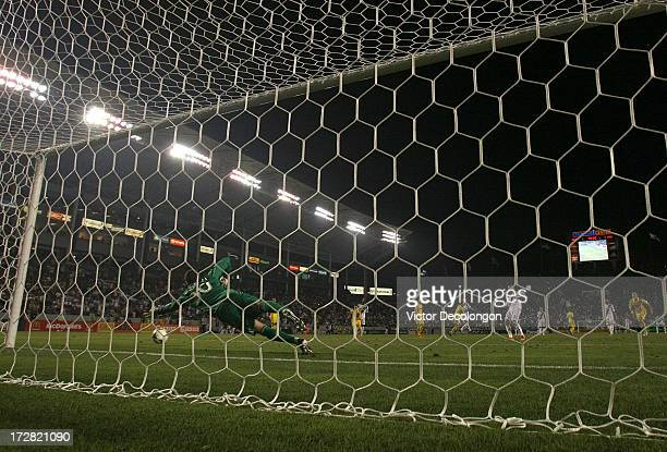 Goalkeeper Andy Gruenebaum of the Columbus Crew can't make the save on the penalty kick by Robbie Keane of the Los Angeles Galaxy in the second half...