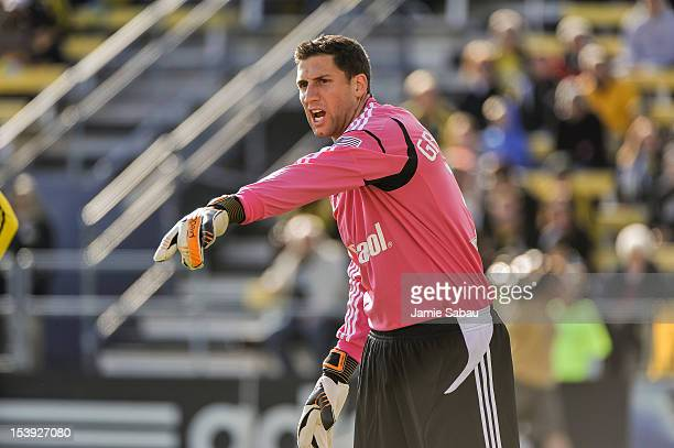Goalkeeper Andy Gruenebaum of the Columbus Crew directs his teammates during a game against Sporting Kansas City on October 7 2012 at Crew Stadium in...