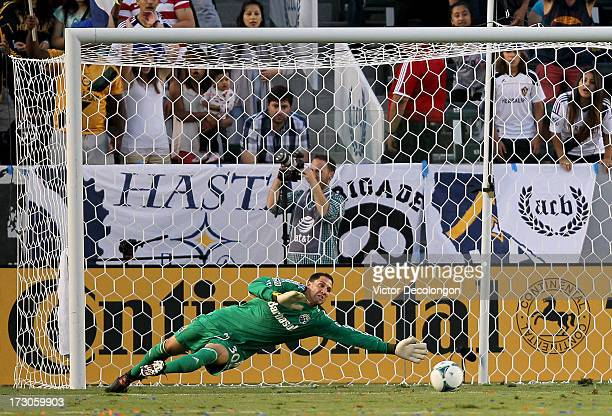 Goalkeeper Andy Gruenebaum of the Columbus Crew dives his left to defend a shot going wide of the net in the first half of their MLS match against...