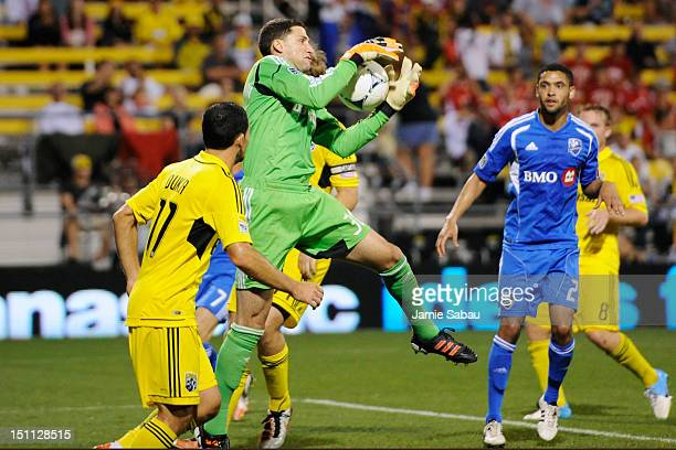 Goalkeeper Andy Gruenebaum of the Columbus Crew gains control of the ball off a Montreal Impact corner kick in the second half on September 1 2012 at...