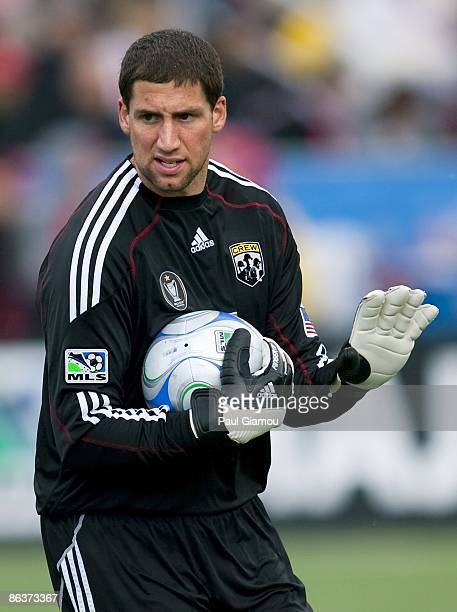 Goalkeeper Andy Gruenebaum of the Columbus Crew hold onto the ball during the match against the Toronto FC at BMO Field on May 2 2009 in Toronto...