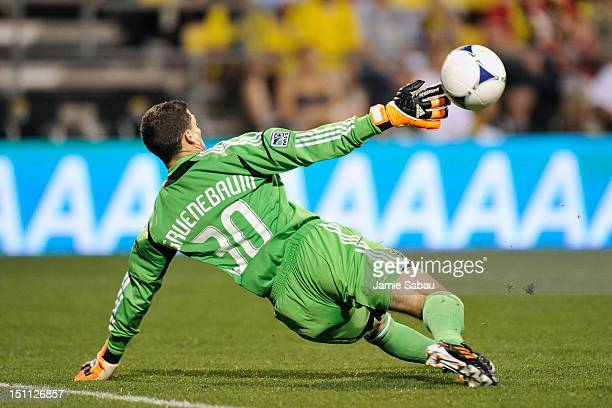 Goalkeeper Andy Gruenebaum of the Columbus Crew is unable to stop a shot from Marco Di Vaio of the Montreal Impact in the second half for Montreal's...