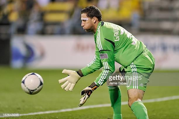Goalkeeper Andy Gruenebaum of the Columbus Crew makes a save against Chivas USA on September 19 2012 at Crew Stadium in Columbus Ohio
