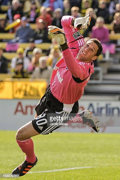 Goalkeeper Andy Gruenebaum of the Columbus Crew makes a save against Sporting Kansas City on October 7 2012 at Crew Stadium in Columbus Ohio