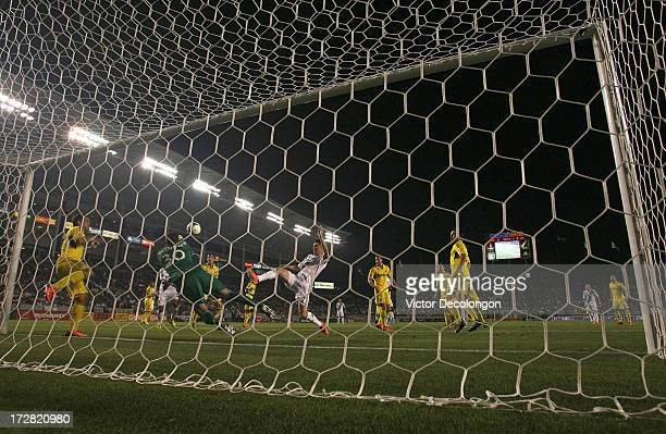 Goalkeeper Andy Gruenebaum of the Columbus Crew punches the ball clear as Robbie Keane of the Los Angeles Galaxy reaches for the ball in the second...