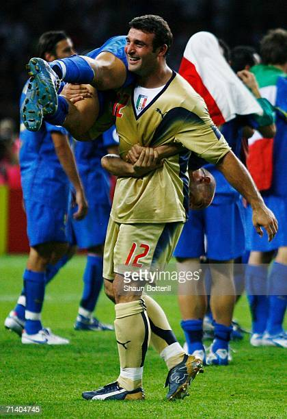 Goalkeeper Angelo Peruzzi carries team mate Alessandro Del Piero on his shoulder following victory during the FIFA World Cup Germany 2006 Final match...