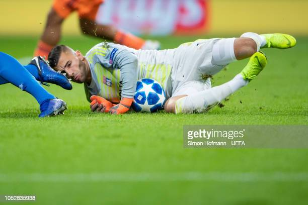 Goalkeeper Anthony Lopes of Lyon clashes with Adam Szalai as he makes a save during the UEFA Champions League Group F match between TSG 1899...