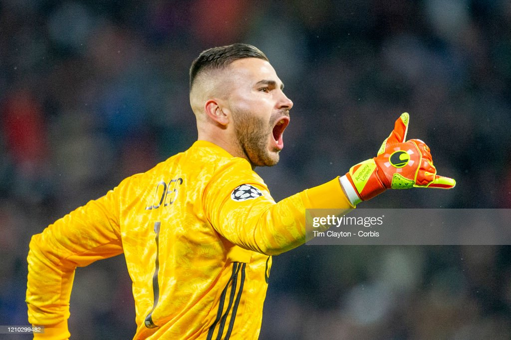 Goalkeeper Anthony Lopes of Lyon reacts after a first half goal ...