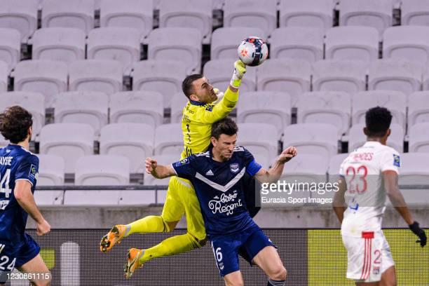 Goalkeeper Anthony Lopes of Olympique Lyon battles for the ball with Laurent Koscienly of Bordeaux during the match between Olympique Lyonnais and...